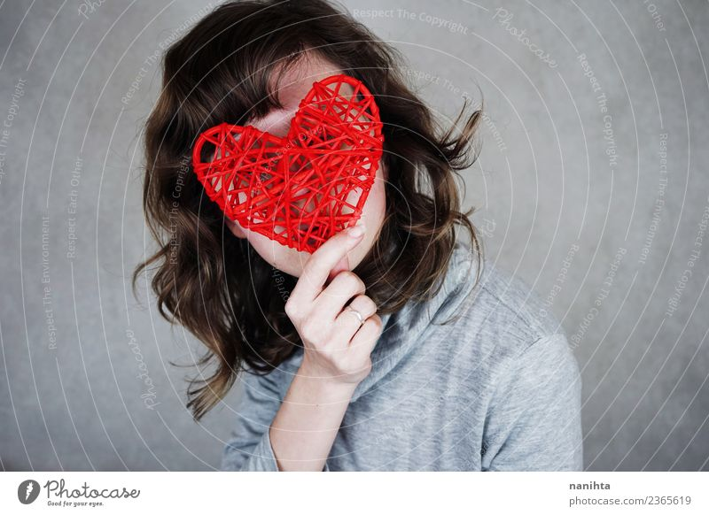 Young woman covering her face with a red heart Style Design Healthy Valentine's Day Mother's Day Human being Feminine Youth (Young adults) 1 18 - 30 years