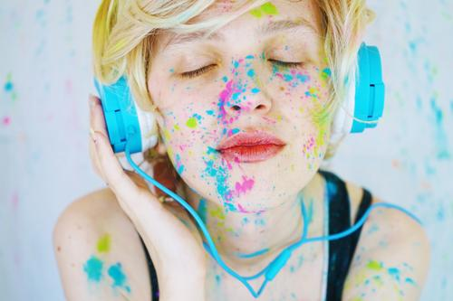 Young woman is listening to music with paint in her face Human being Youth (Young adults) Beautiful 18 - 30 years Adults Lifestyle Emotions Feminine Style Art