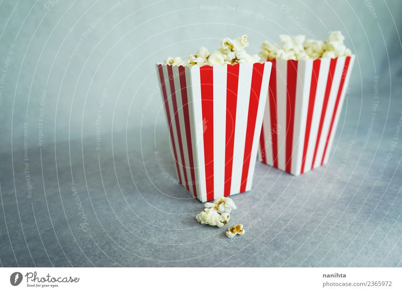 Two classic boxes of popcorn Food Popcorn Cereal Nutrition Vegetarian diet Leisure and hobbies Entertainment Going out Culture Cinema Stripe Simple Together