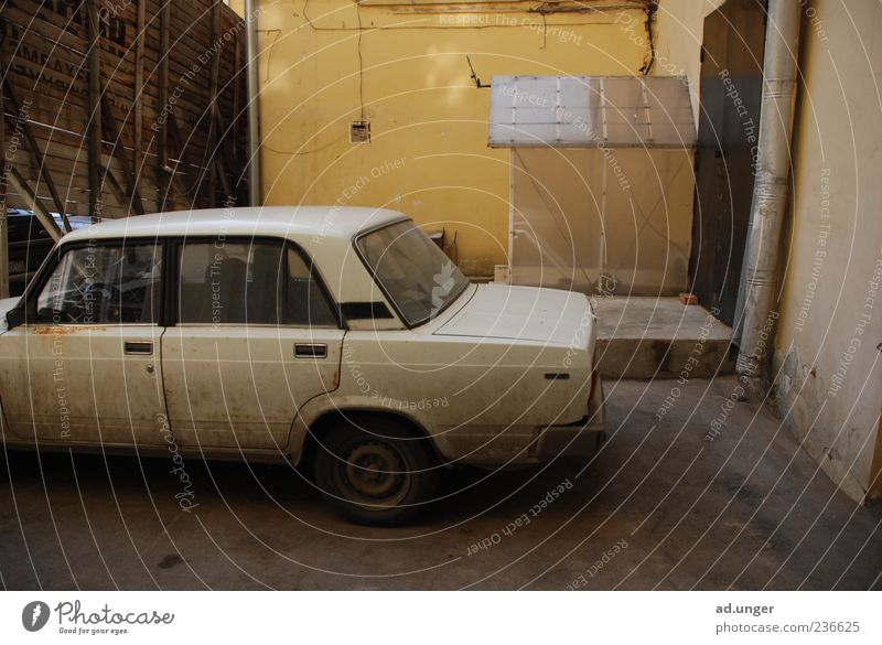 pinaco lada Car Vintage car Old Authentic Dirty Good Historic White Joy Politics and state Colour photo Exterior shot Deserted Copy Space right Shadow