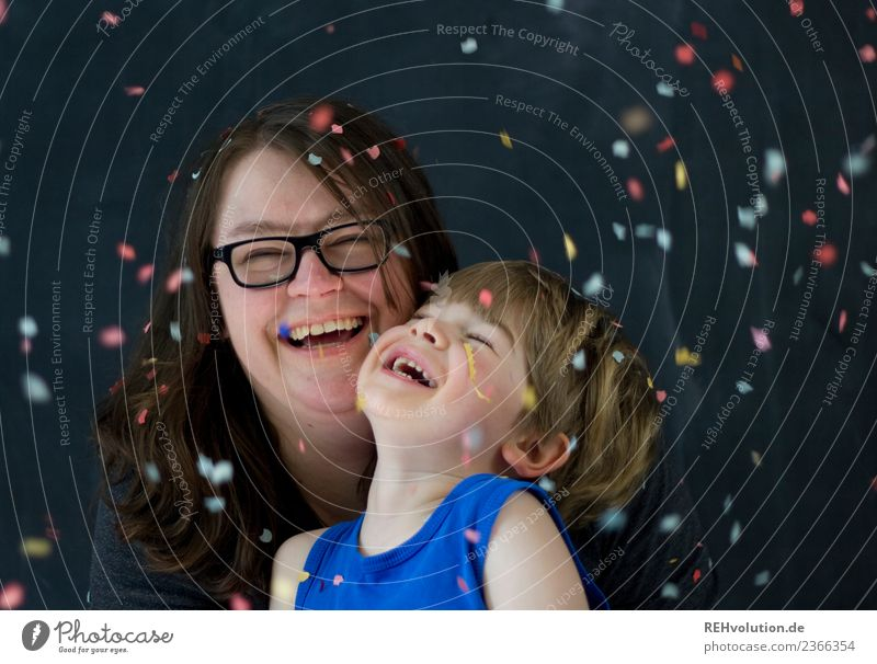 Mother and child laugh with confetti Lifestyle Joy luck Human being Masculine Feminine Child Boy (child) Woman Adults Family & Relations Infancy Face 2