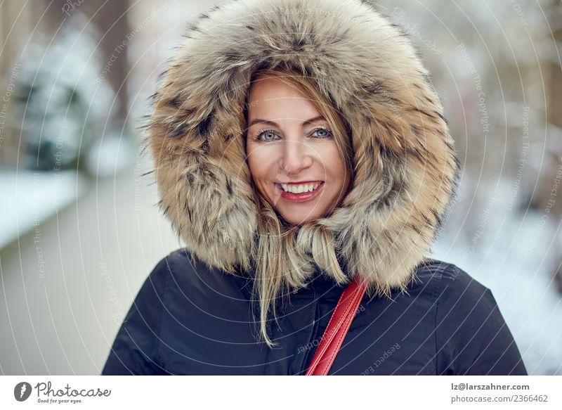 Portrait of smiling woman wearing winter hood Lifestyle Happy Beautiful Face Winter Snow Woman Adults 1 Human being 30 - 45 years Park Fashion Coat Fur coat