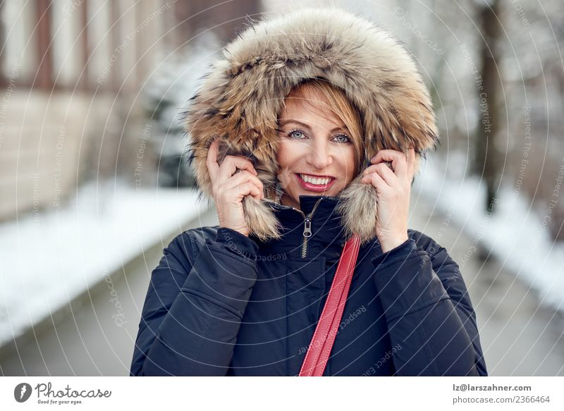Portrait of smiling woman wearing winter hood Lifestyle Happy Beautiful Face Winter Snow Woman Adults 1 Human being 45 - 60 years Park Fashion Coat Fur coat