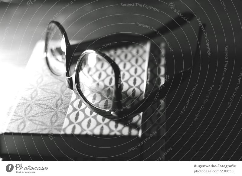 bedtime reading Print media Book Eyeglasses Black & white photo Interior shot Copy Space right Artificial light Shadow Contrast Blur Deserted Lie 1