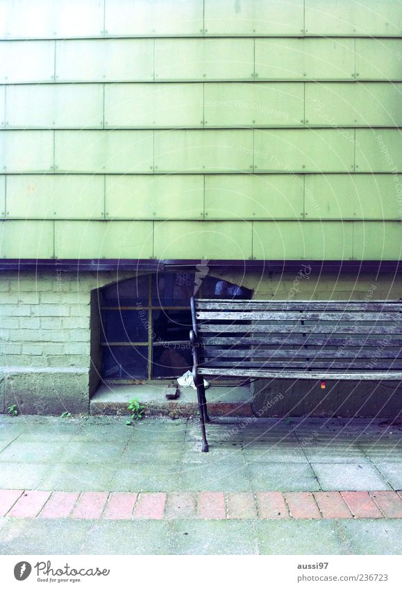 Getting on the wrong track Bench Old building Seating Relaxation Break Restful Broken Loneliness Cellar window Copy Space top Tilt Deserted Street Sidewalk