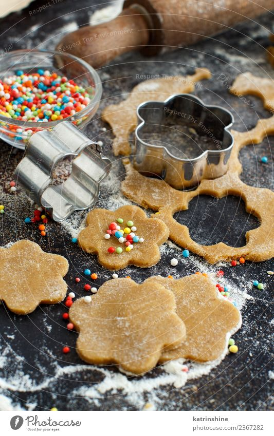 Cooking cookies with flower cookie cutters on a dark table Dough Baked goods Dessert Kitchen Flower Metal Make Brown Tradition Baking Bakery biscuit cooking