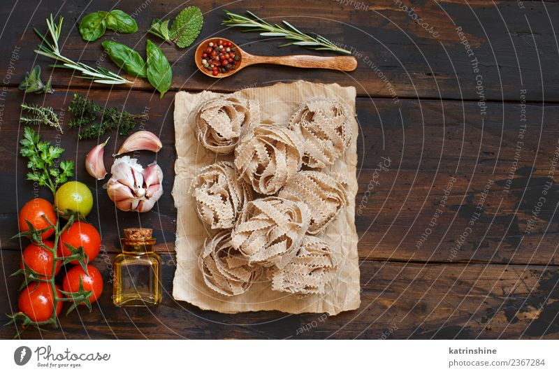 Whole wheat pasta tagliatelle, vegetables and herbs Green Red Leaf Dark Brown Copy Space Fresh Table Tradition Diet Meal Vegetarian diet Tomato Rustic Raw