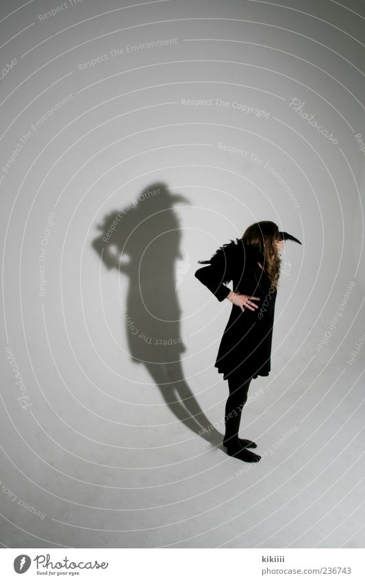 shadow Black Shadow Beak White Structures and shapes Bird Raven birds Costume Carnival costume Girl Stand Copy Space Studio shot Human being Dress up Crow Mask