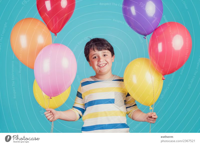happy and smiling boy with colorful balloons Lifestyle Joy Vacation & Travel Adventure Freedom Party Event Feasts & Celebrations Birthday Human being Masculine