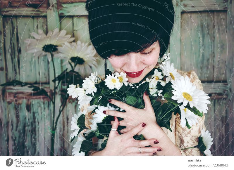 Young woman hugging a bouquet of flowers Woman Human being Youth (Young adults) Beautiful Flower Joy 18 - 30 years Adults Lifestyle Love Feminine Style Design
