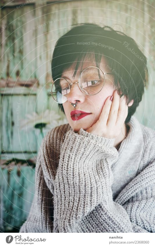 Portrait of young woman wearing glasses Woman Human being Youth (Young adults) Young woman Beautiful Loneliness 18 - 30 years Lifestyle Adults Warmth Wood