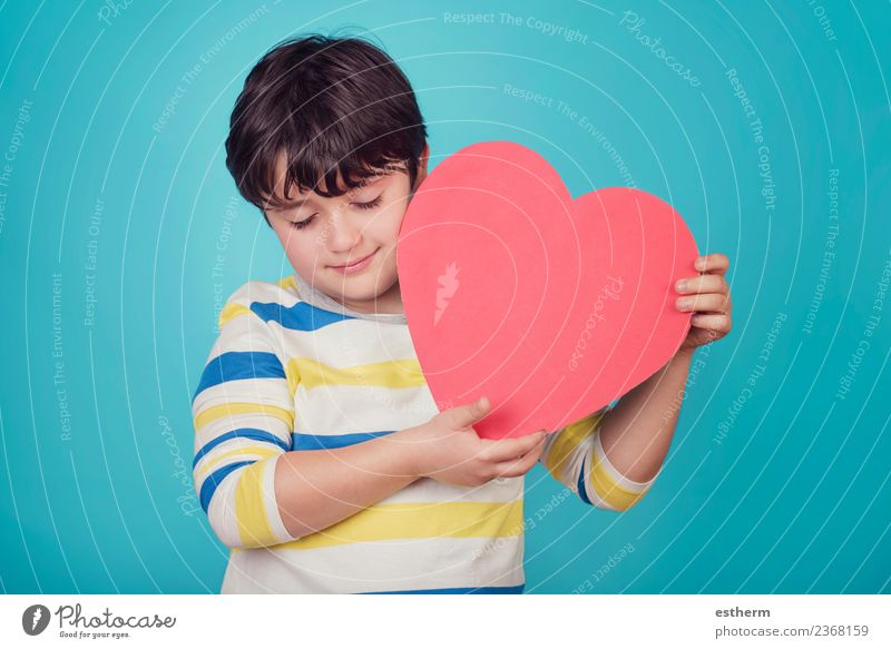 smiling boy with a heart on blue background Child Human being Joy Lifestyle Love Emotions Party Feasts & Celebrations Think Friendship Masculine Infancy