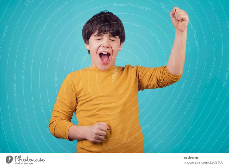 smiling and euphoric boy on blue background Child Human being Joy Lifestyle Emotions Boy (child) Happy Feasts & Celebrations Masculine Infancy Power Happiness