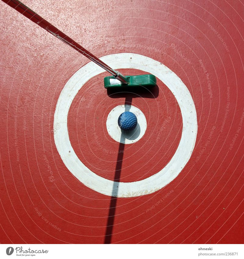 Put a quiet bullet in it. Mini golf Trip Ball sports Golf ball Mini golfclub Sporting Complex Sunlight Round Red Playing Tee off Point Circle Colour photo