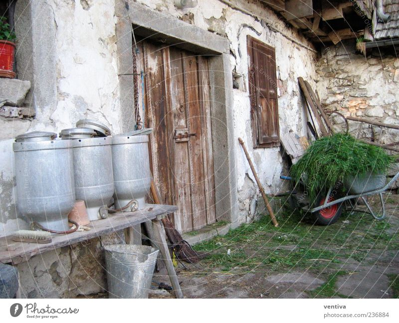 Farm milk cans Stone Work and employment Authentic Conscientiously Diligent Homesickness Past Colour photo Exterior shot Deserted Day Central perspective