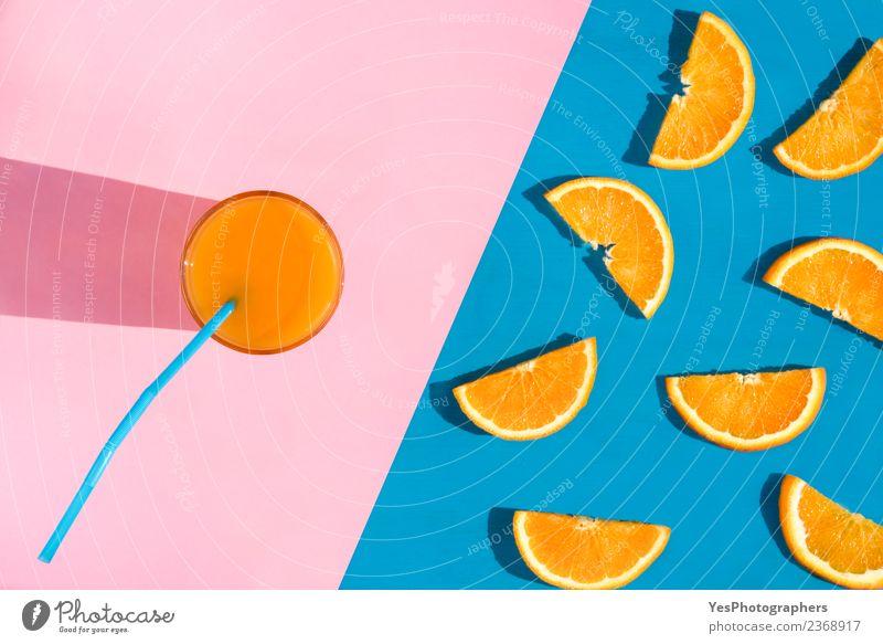 Glass with orange juice Fruit Orange Breakfast Diet Beverage Cold drink Juice Summer Fresh Healthy Delicious Juicy Pink Colour above view Blue background citrus
