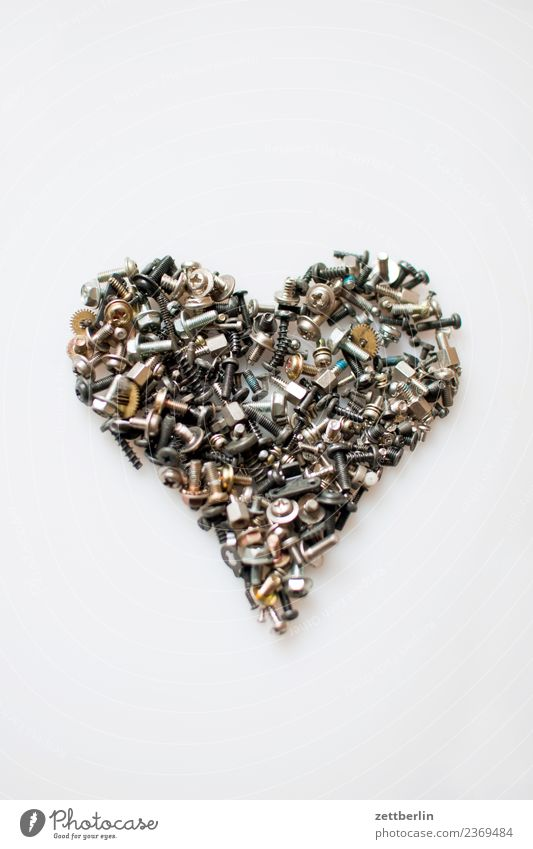Heart of Gold Muddled precision engineering Isolated Image small part Love Declaration of love Mechanics Crowd of people Deserted Metal Metalware Mother Repair