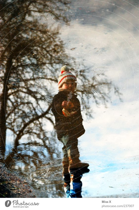 Human being Child Water Street Cold Lanes & trails Weather Infancy Dirty Wet Stand Toddler Cap Puddle Bad weather Hop