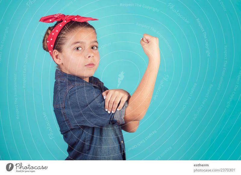 girl feminism,girl showing her muscular arm Lifestyle Joy Human being Feminine Girl Infancy 8 - 13 years Child Think To hold on Fitness Success Muscular