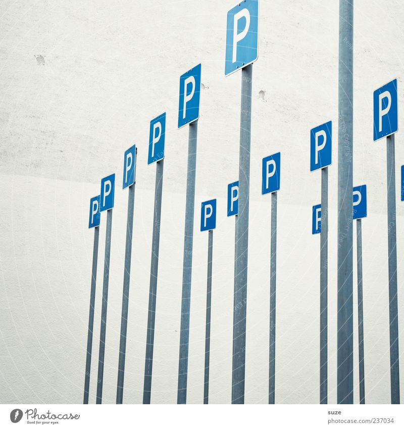 Blue Wall (building) Funny Wall (barrier) Gray Signs and labeling Sign Many Parking lot Parking Road sign Road sign Sign forest Search for a parking space Lack of parking spaces Bright background