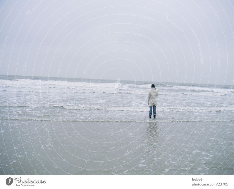 Lonely one Clouds Ocean Lake White crest Beach Wet Cold Jacket Cap Boots Mud flats whoiscocoon