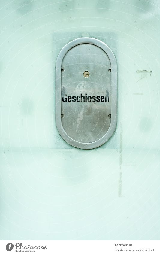 closed Glass Metal Sign Characters Hatch Counter Window Civil servant Closed Opening time Colour photo Subdued colour Exterior shot Deserted Copy Space left