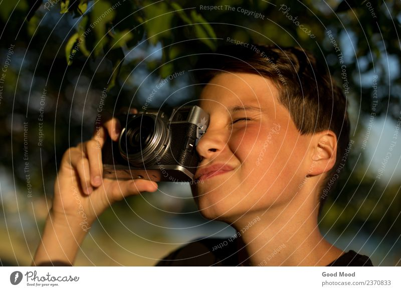 Young photographer with retro film photo camera in garden Human being Nature Vacation & Travel Youth (Young adults) Man Summer Beautiful Green Sun Hand Tree