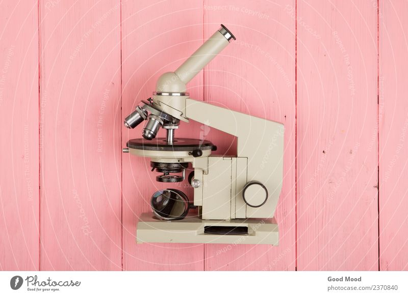 Microscope on pink wooden table Medication Table Science & Research School Academic studies Laboratory Technology Eyes Wood Retro Pink education scientific