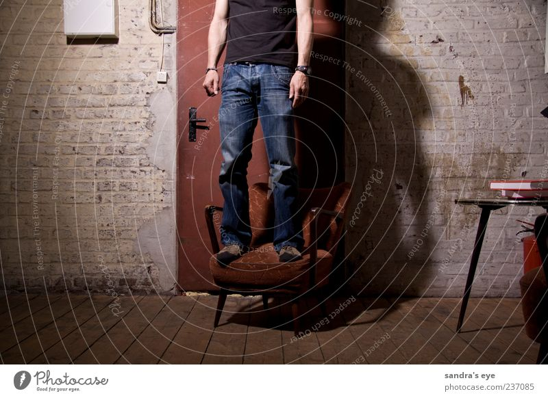 doormen Armchair Human being Masculine Man Adults 1 Factory Door Clothing T-shirt Jeans Wristwatch Footwear Stand Wait Thin Calm Red Blue Wall (building)