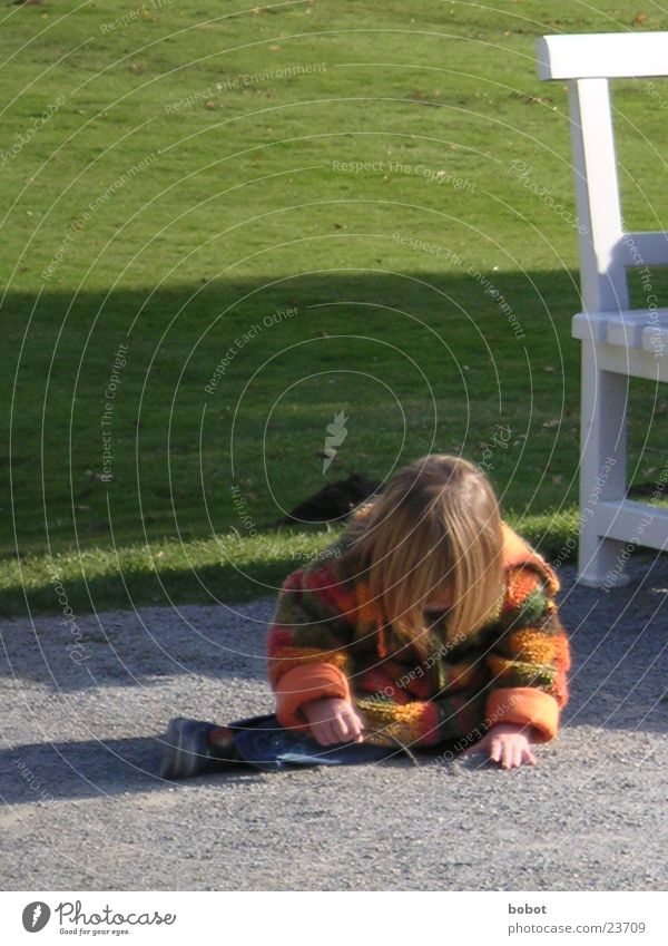 Child Sun Girl Meadow Playing Stone Sit Beautiful weather Crooked Leisure and hobbies Playful