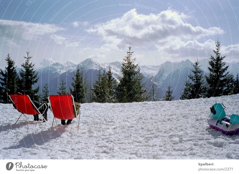 Sunbathing in the snow Deckchair Vacation & Travel Snow Mountain