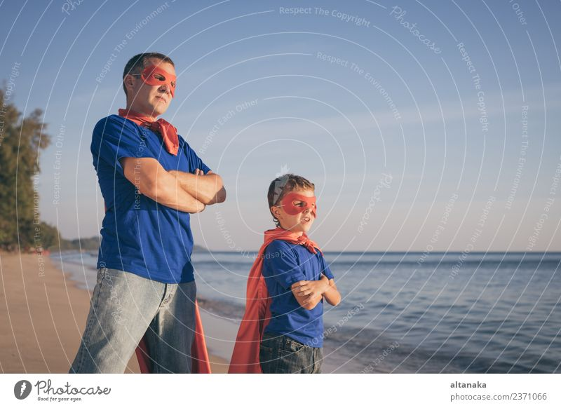 Father and son playing superhero on the beach at the day time. Lifestyle Joy Happy Relaxation Leisure and hobbies Playing Vacation & Travel Adventure Freedom