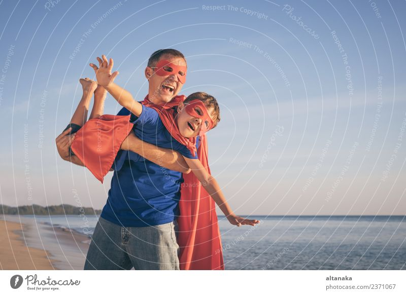 Father and son playing superhero on the beach at the day time. Child Nature Vacation & Travel Man Summer Relaxation Joy Beach Adults Life Lifestyle Emotions