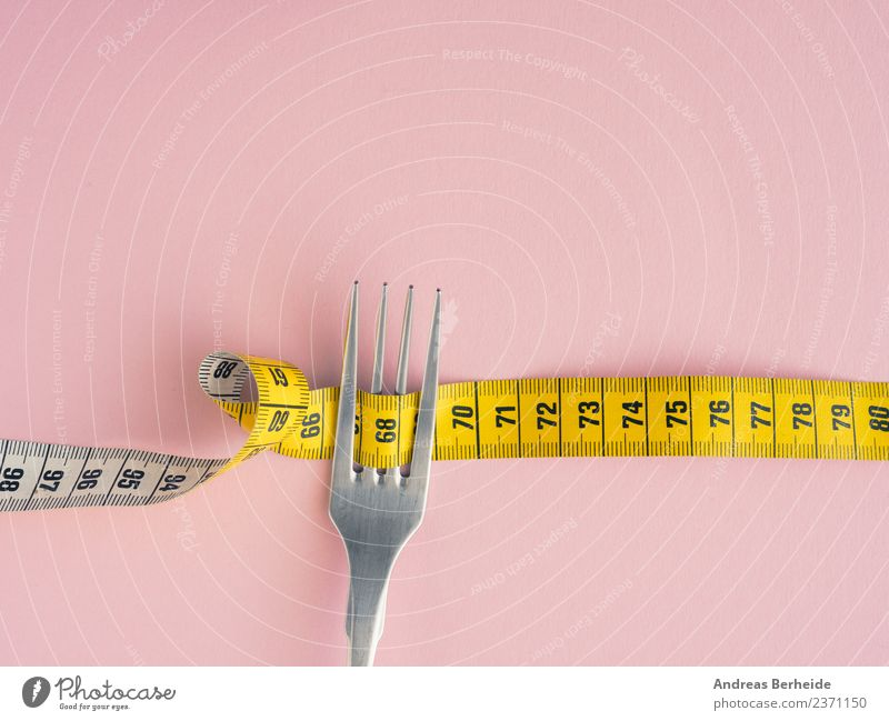 diet Nutrition Diet Fasting Lifestyle Healthy Healthy Eating Overweight Fitness Yellow Pink copy space Tape cassette fork measure loose isolated white concept