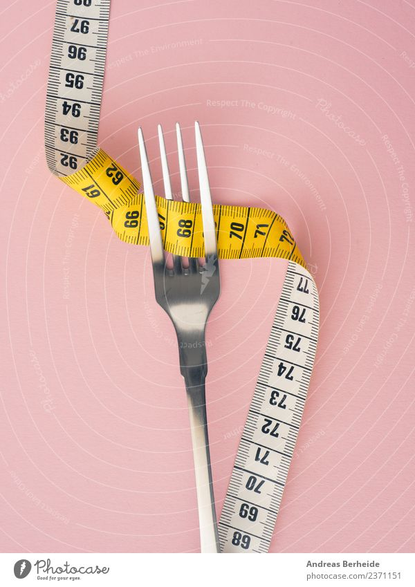 Diet, fork with tape measure Nutrition Fasting Fork Lifestyle Healthy Eating Overweight Fitness Yellow Pink Esthetic Personal hygiene cutlery dieting exercise