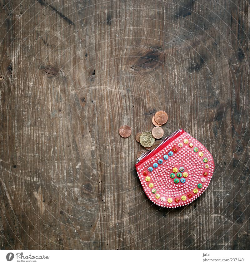 coin bag Money Coin Euro Money purse Kitsch Wooden table Means of payment Colour photo Interior shot Deserted Copy Space left Copy Space top Day Cent Small 1