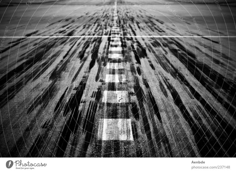 Exceptional Transport Esthetic Airplane takeoff Airport Airplane landing Movement Black & white photo Runway Skid marks Structures and shapes Signs and labeling Marker line