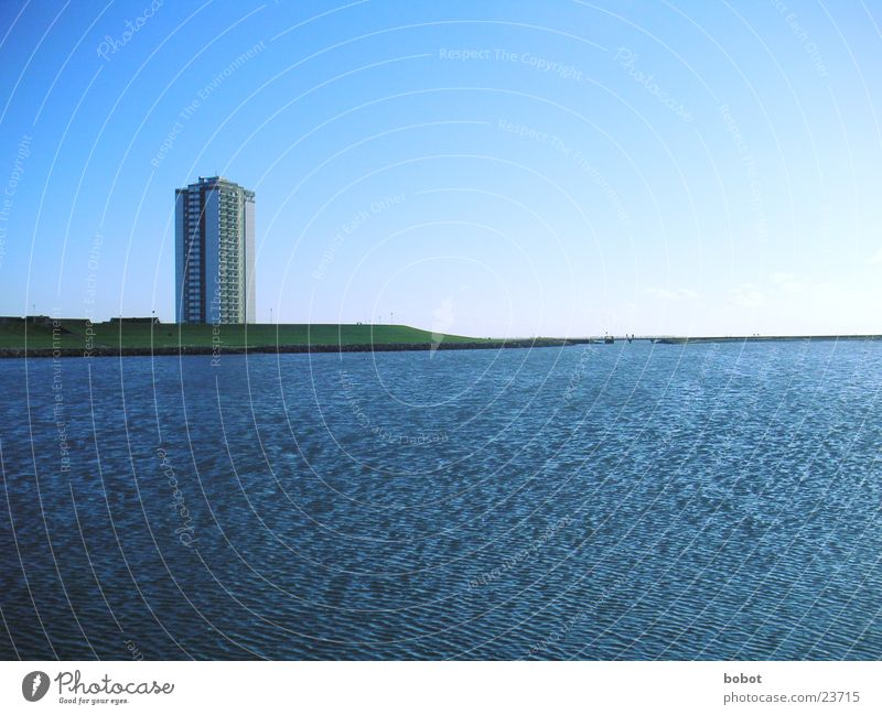 Wide open Cold Ocean Lake Coast Ice Wind Far-off places Longing Dike High-rise House (Residential Structure) Vantage point Hotel Architecture Beautiful weather