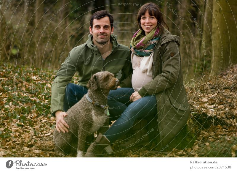 Couple with dog in the forest Lifestyle Leisure and hobbies Human being Masculine Feminine Family & Relations Partner 2 30 - 45 years Adults Environment Nature