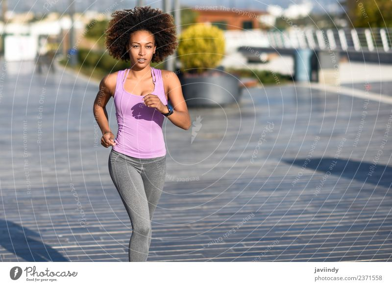 Black woman, afro hairstyle, running outdoors Lifestyle Beautiful Hair and hairstyles Wellness Leisure and hobbies Sports Jogging Human being Young woman