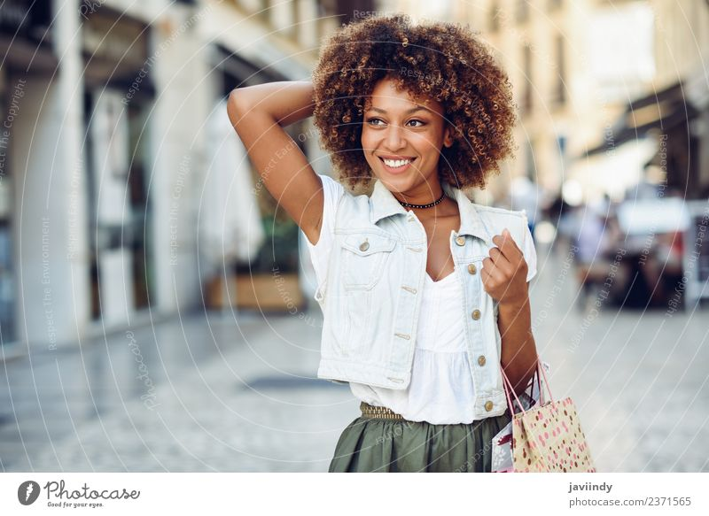 Black woman, afro hairstyle, with shopping bags outdoors Lifestyle Shopping Style Happy Beautiful Hair and hairstyles Human being Feminine Young woman
