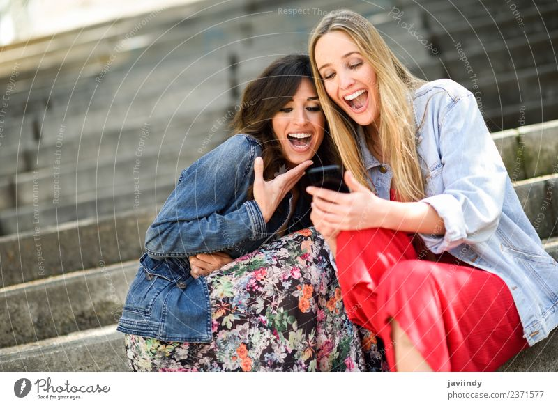 af815c849b Two young women looking at funny things on smartphone Woman Human being  Youth (Young adults