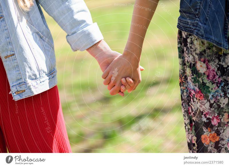 Two young women in walking holding her hands Lifestyle Joy Happy Beautiful Human being Young woman Youth (Young adults) Woman Adults Friendship Couple Hand 2