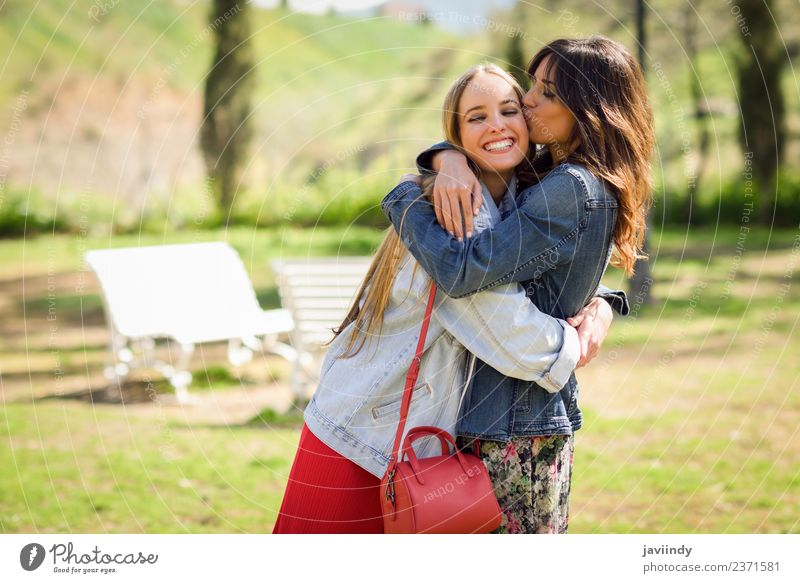 Young woman kissing her friend face outdoors. Lifestyle Style Joy Happy Beautiful Human being Feminine Youth (Young adults) Woman Adults Friendship 2