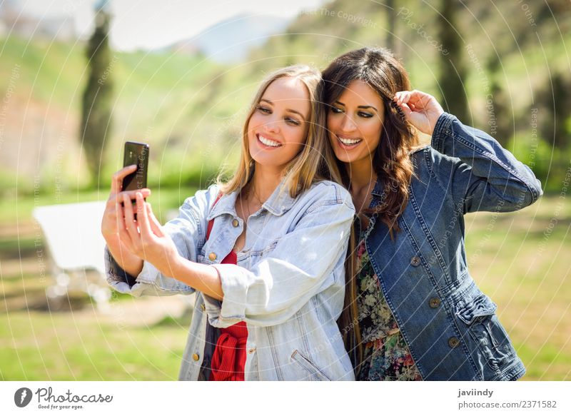 Two young women taking a selfie photograph Lifestyle Style Joy Happy Beautiful Summer Telephone Camera Human being Feminine Young woman Youth (Young adults)