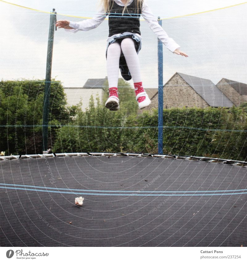 take off! Trampoline Human being Child Girl 1 Dress Tights Blonde Long-haired Flying Playing Jump Small Hop Air Childlike Joy Colour photo Exterior shot