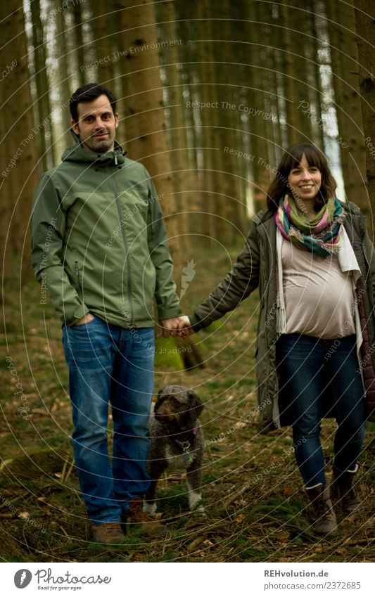 Couple goes for a walk in the forest Forward Full-length Long shot Shallow depth of field blurriness Shadow Day Exterior shot Colour photo To go for a walk