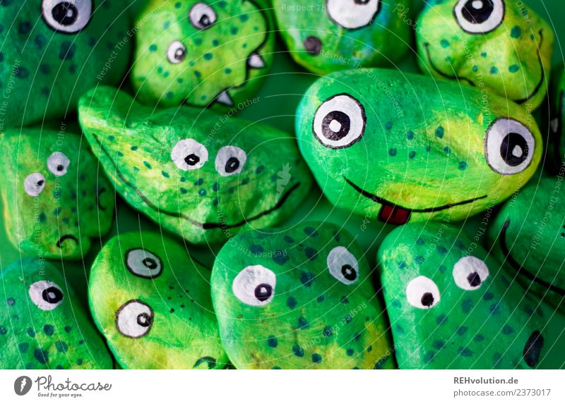 Monster Stones | green Joy Happy Leisure and hobbies Face Group Art Artist Work of art Culture Smiling Exceptional Cool (slang) Together Funny Green Friendship