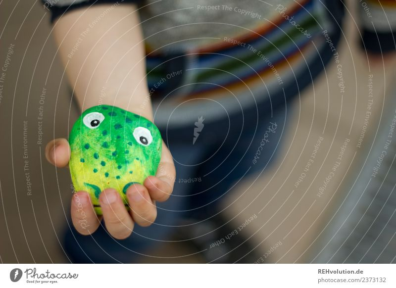 Monster stone in hand Lifestyle Style Happy Human being Hand 1 3 - 8 years Child Infancy Stone To hold on Playing Exceptional Natural Joy Idea Creativity
