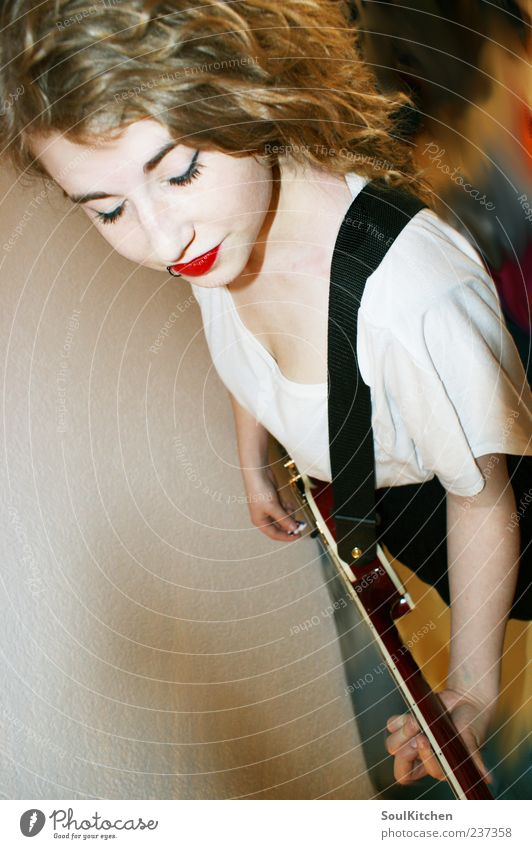play loud Feminine Young woman Youth (Young adults) 1 Human being 18 - 30 years Adults Rockabilly Music Musician Guitar Yellow Black White Style Colour photo